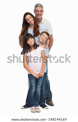 Portrait of a smiling family in single file on white background
