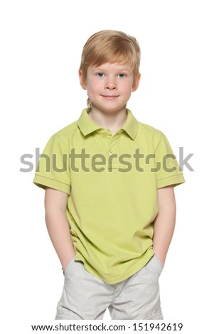 Portrait of a smiling fashion red-haired boy on the white background