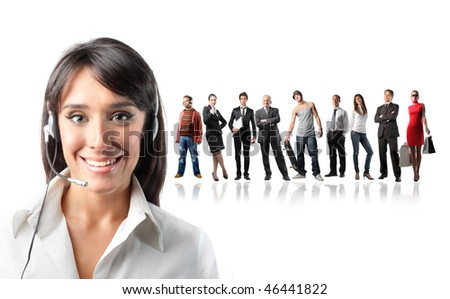 Portrait of a smiling female operator with a group of different people on the background - stock photo