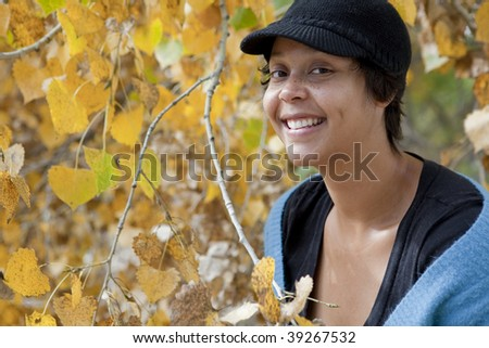 Portrait of a smiling, freckled, light skinned black woman - stock photo