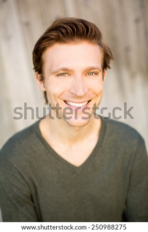 Portrait of a smiling friendly man - stock photo