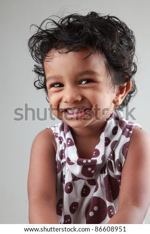 Portrait of a smiling girl child - stock photo