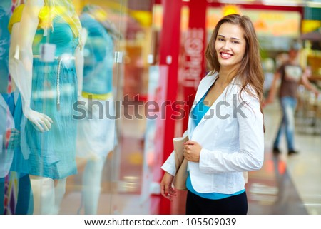 Portrait of a smiling girl hanging out in a shopping center