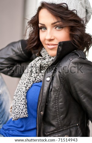 Portrait of a smiling girl in a grey hat - stock photo