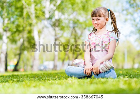 portrait of a smiling girl in a park - stock photo
