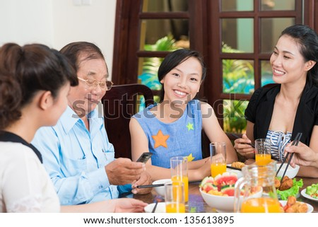 Portrait of a smiling girl looking at camera - stock photo