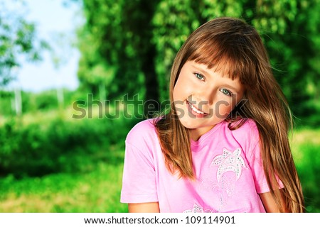 Portrait of a smiling girl outdoor.