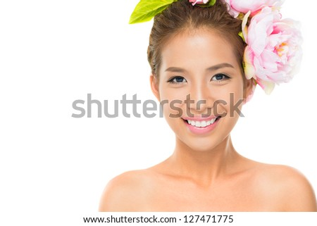 Portrait of a smiling girl with flower hairdo isolated against white background - stock photo