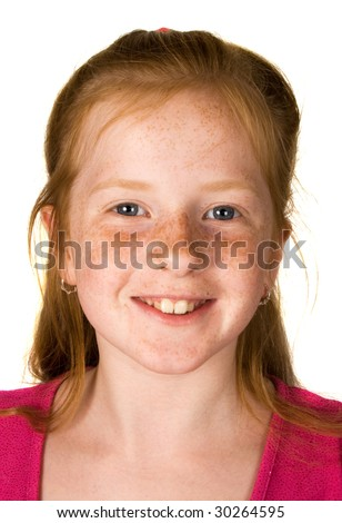 Portrait of a smiling girl with red hair and freckles