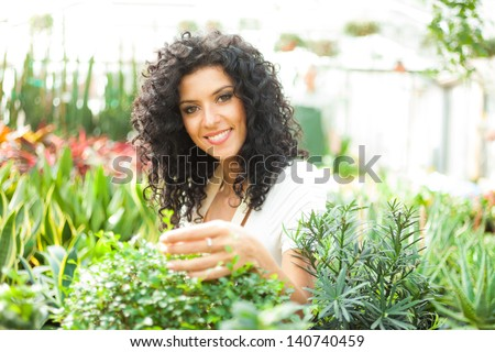 Portrait of a smiling greenhouse worker - stock photo