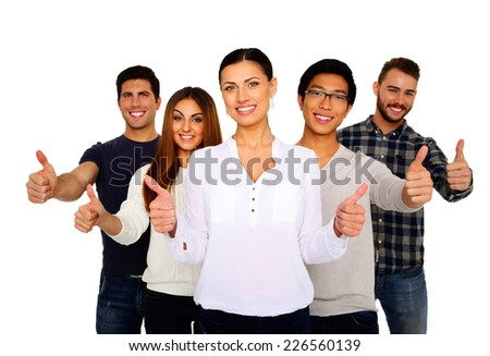 Portrait of a smiling group of people with thumbs up - stock photo