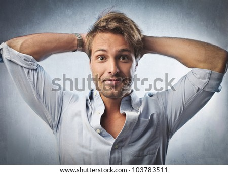 Portrait of a smiling handsome young man - stock photo