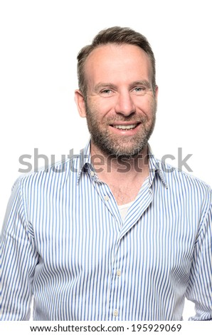 Portrait of a smiling happy handsome middle-aged man with a beard wearing a striped shirt looking at the camera with a warm friendly smile against a white studio background