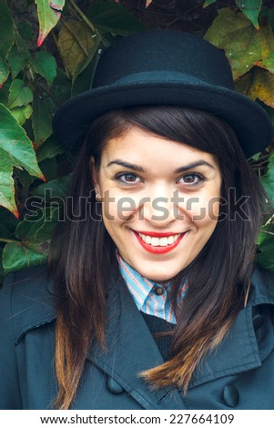 Portrait of a smiling hipster girl,selective focus - stock photo