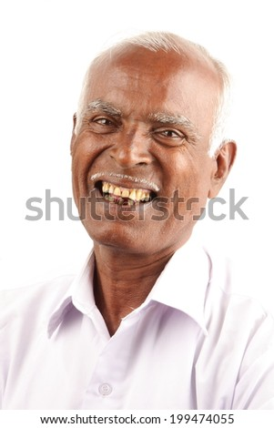 Portrait of a smiling Indian senior citizen. - stock photo