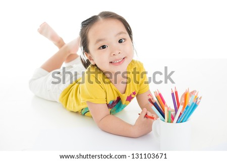 Portrait of a smiling kid on the floor isolated - stock photo