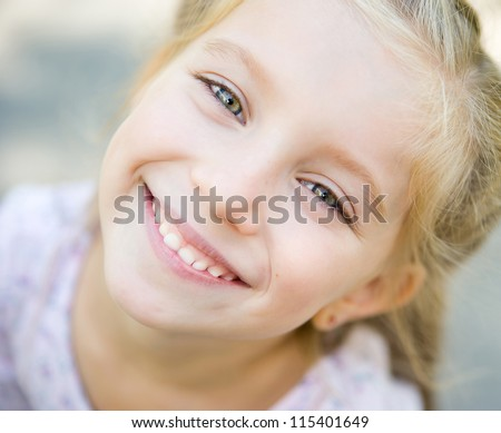 Portrait of a smiling liitle girl - stock photo