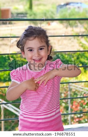 Portrait of a smiling little girl as a concept of happiness - stock photo