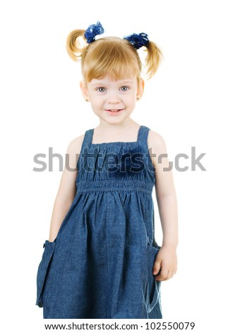 Portrait of a smiling little girl hiding one her hand in the pocket - stock photo