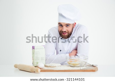 Portrait of a smiling male chef cook baking isolated on a white background - stock photo