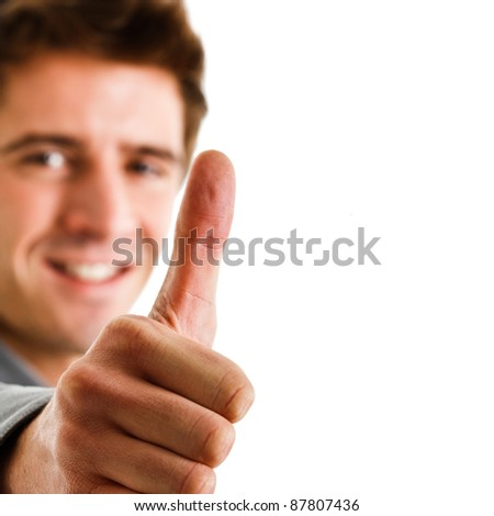 Portrait of a smiling man giving thumbs up - stock photo