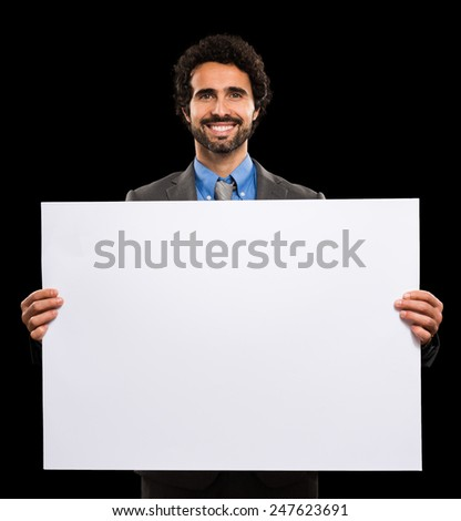 Portrait of a smiling man holding a white sheet - stock photo
