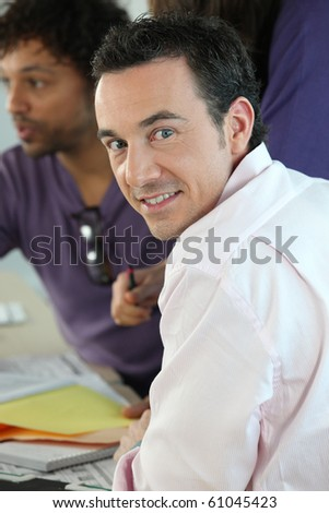 Portrait of a smiling man in the office - stock photo
