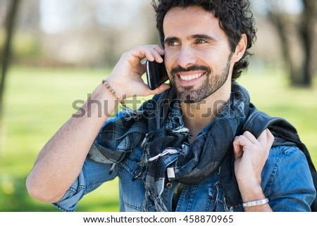 Portrait of a smiling man talking on the phone