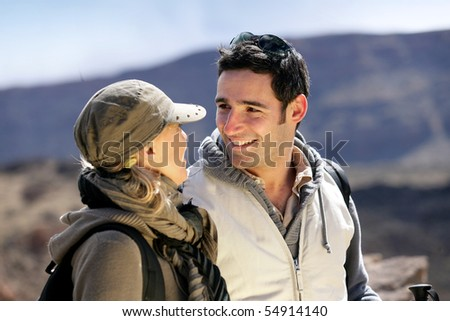 Portrait of a smiling man watching a woman - stock photo
