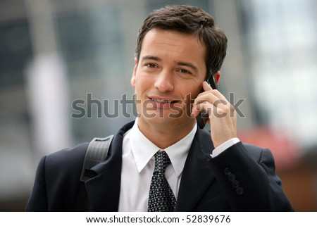 Portrait of a smiling man with a cell phone