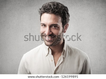 Portrait of a smiling man with a white shirt