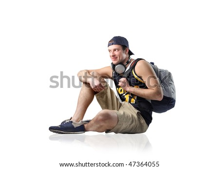 Portrait of a smiling man with headphones and rucksack - stock photo