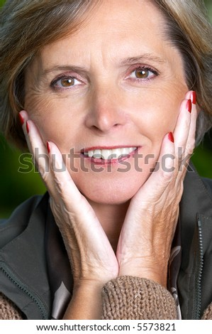 Portrait of a smiling mature woman - stock photo