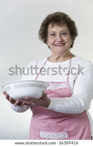 Portrait of a smiling mature woman with a bowl.