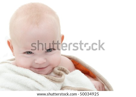 Portrait of a smiling mischievous baby. - stock photo