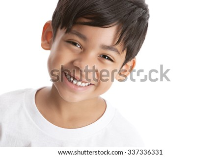 Portrait of a smiling mixed race boy.  Isolated on white with room for your text. - stock photo