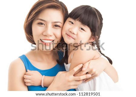 Portrait of a smiling mother embracing her little daughter - stock photo