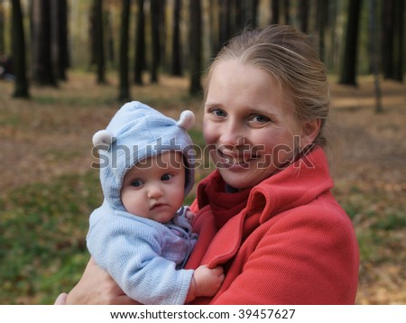 Portrait of a smiling mother with her baby - stock photo