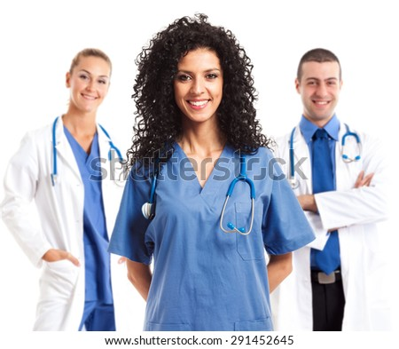 Portrait of a smiling nurse in front of her team - stock photo
