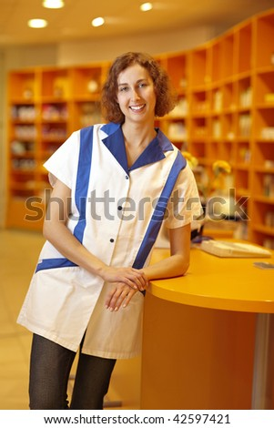 Portrait of a smiling pharmacist in pharmacy - stock photo