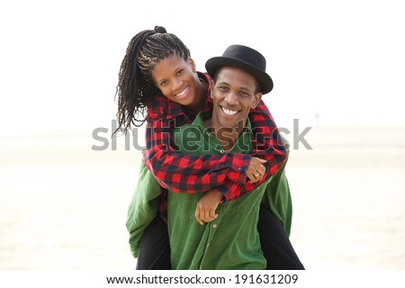 Portrait of a smiling playful young couple enjoying outdoors  - stock photo