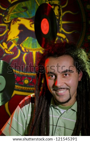 Portrait of a smiling rastaman before the concert