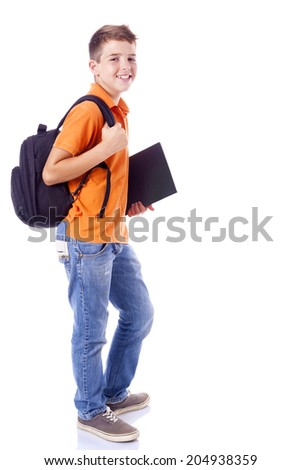 Portrait of a smiling school boy with backpack holding a notebook, isolated on white background