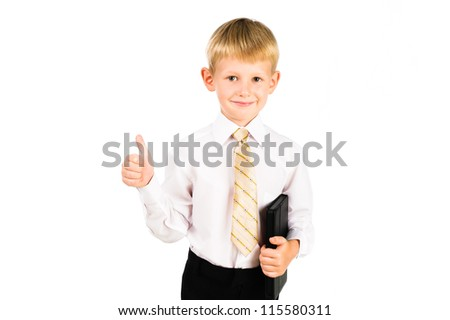 Portrait of a smiling schoolboy holding pad with thump up sign isolated over white - stock photo