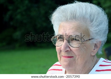Portrait of a smiling senior citizen woman at a playground.