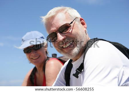 Portrait of a smiling senior couple of hikers