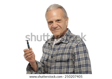 Portrait of a smiling senior man holding Electronic Vapor Cigarette  against white background - stock photo