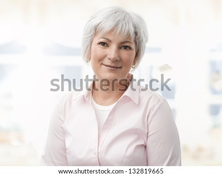 Portrait of a smiling senior woman in her living room