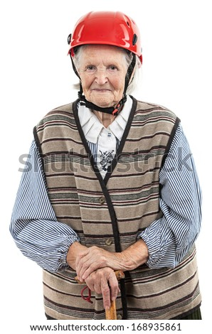 Portrait of a smiling senior woman in red helmet looking at the camera. Over white background.  - stock photo