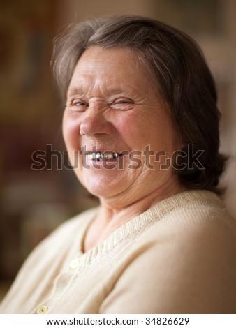 Portrait of a smiling senior woman - shallow DOF - stock photo